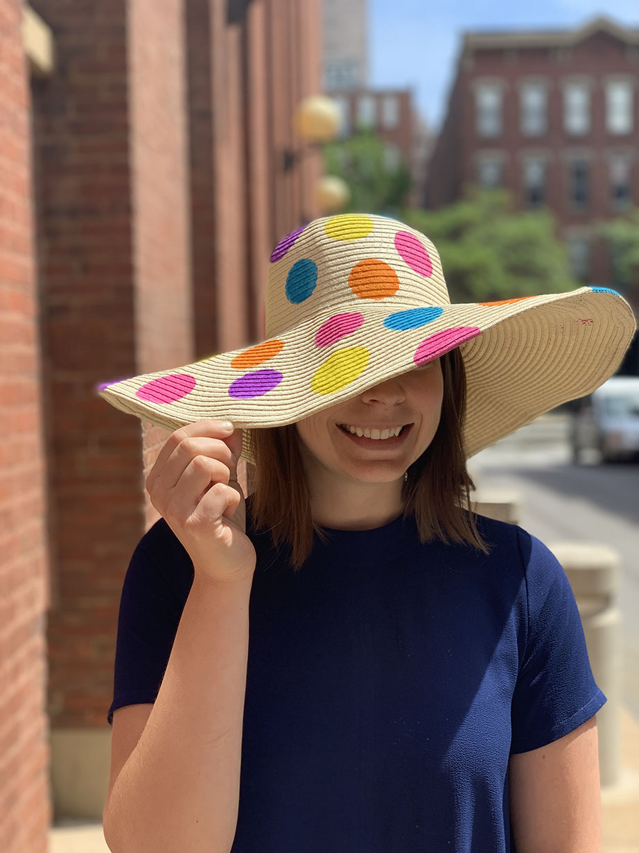 woman wearing floppy hat